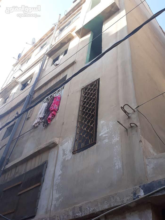 عمارة للبيع في حي معصوم شارع حمزة بن عبدالله بقرب من مدرسة حي رمزي المختلطة