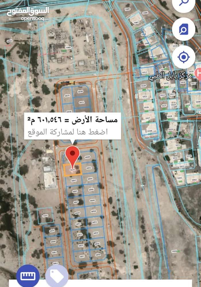 أرض خلف مركز بابل الطبي وقريبه من تقاطع المحج