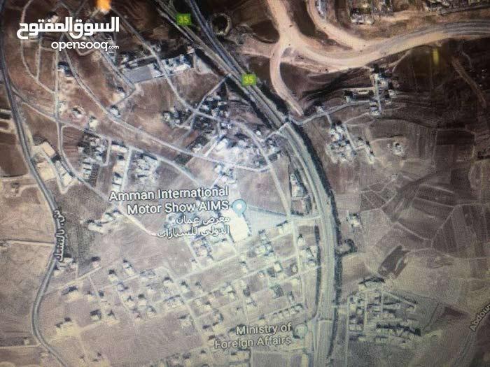 الظهير أرض لقطة 2 دنم على ش المطار- الخارجية