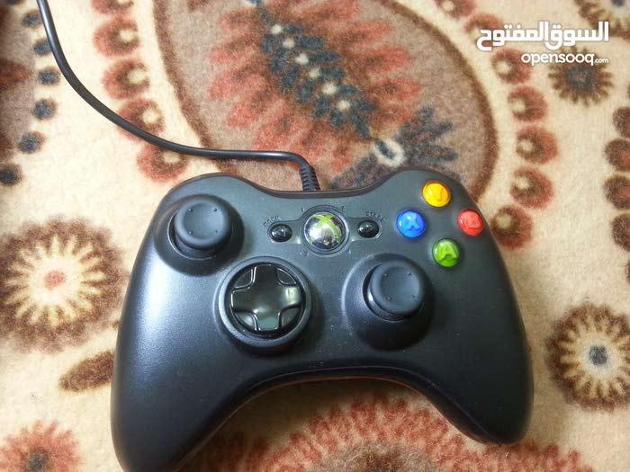 اكس بوكس 360 مستعمل يعمل جيدا مع يدة وايرليس (مو اصلية) مع 32لعبة مع العلبة