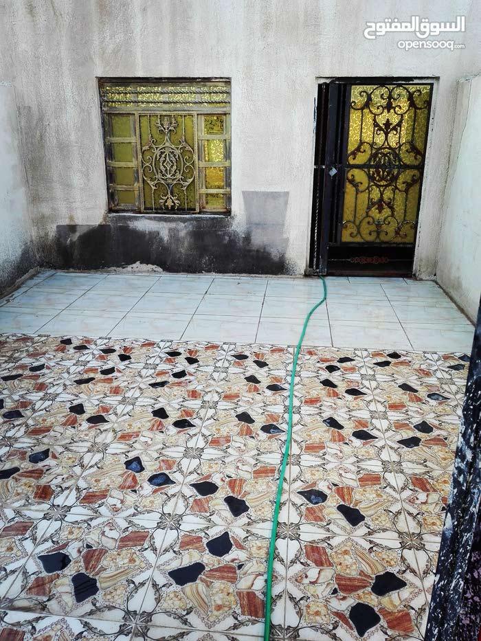 للبيع بيت مساحة 120 متر تجاوز في منطقة حي الجامعة شارع حسينية أصحاب الكساء