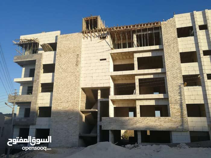 شقة ارضية بتشطيب فندقي ومواصفات عالية اقساط في شفا بدران ومن المالك مباشرة