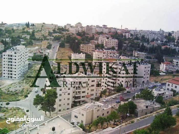 ارض تجاري ضمن سكن للبيع في منطقه حيويه في الجندويل المساحه :(836م)