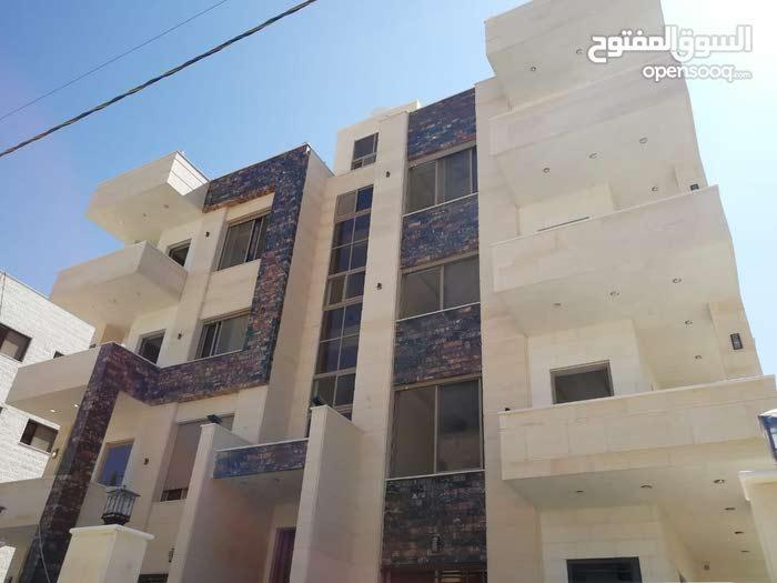 شقة اقساط في مرج الحمام((خلف حديقة الامانة)) ومن المالك مباشرة