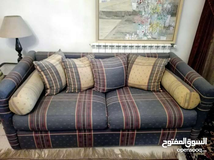 2 seater sofa blue and ochre color