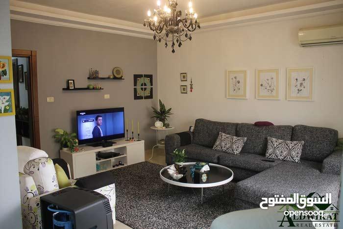 Al Rawnaq neighborhood Amman city - 310 sqm apartment for sale