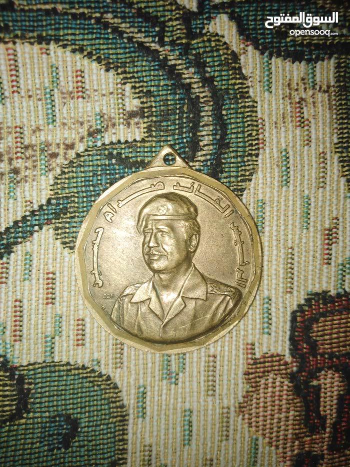 مذاليه صدام حسين نحاس اصفر قديمه للبيع