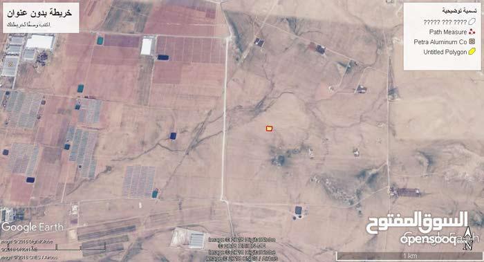 ارض للبيع طريق عمان التنموي الذهيبه الغربيه مساحه 900م