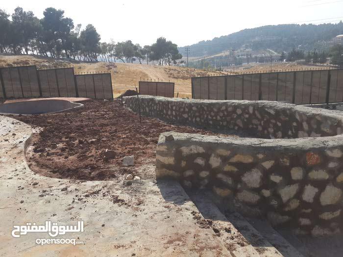 جدران حجريه وسناسل وتشييك مزارع