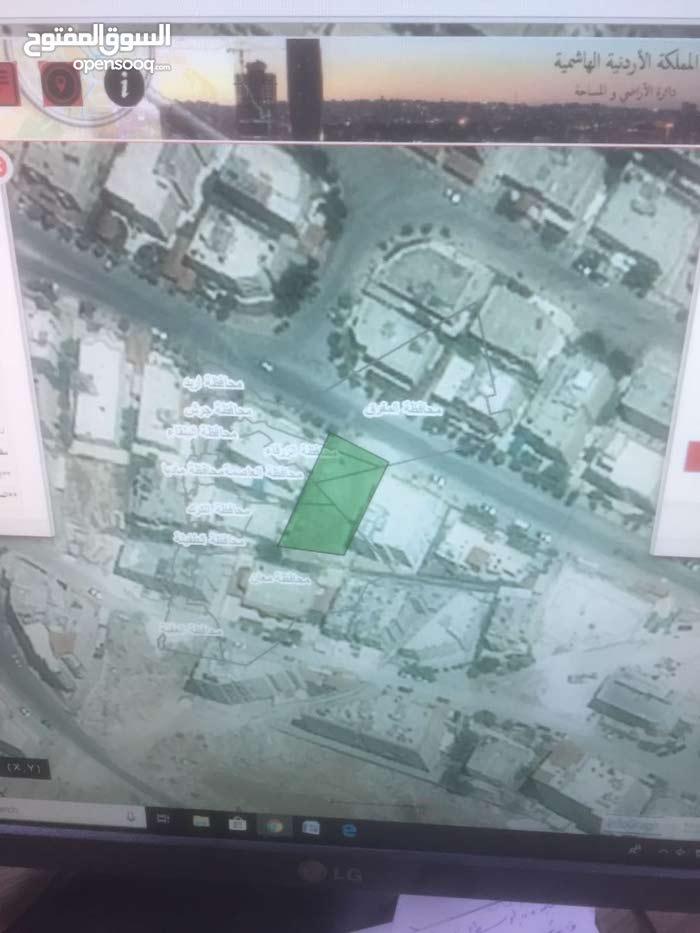 ارض للبيع في شارع الاستقلال بجانب مسجد ابو بكر