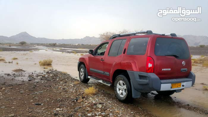 Nissan Xterra 2013 For sale - Red color