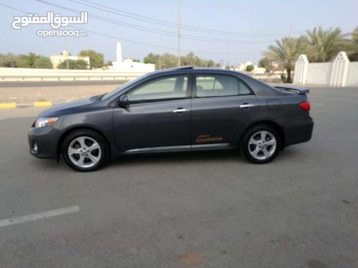 Brown Toyota Corolla 2013 for sale
