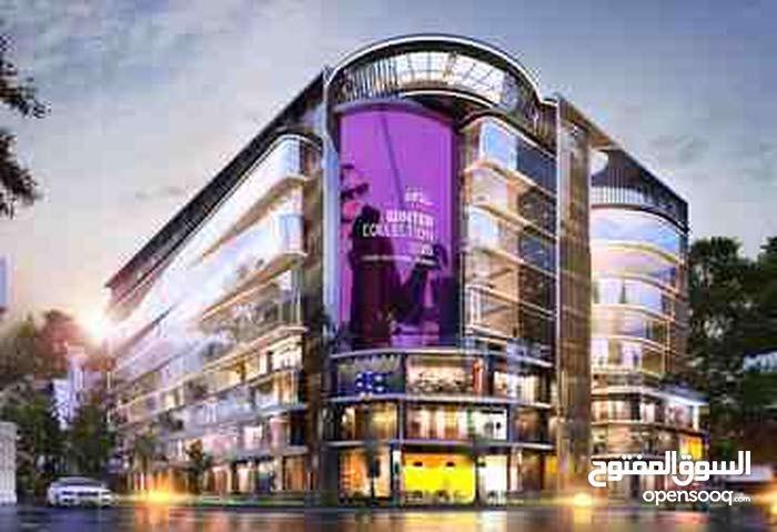 بتدور علي استثمار مضمون في أكثر الكومبوندات مبيعاً في العاصمة الإدارية يبقي oia hub mall