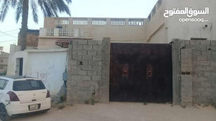 نص منزل عربي واجهتين الارض145م مصين غرفة وصالة سوق الجمعة شارع الكنار 275ألف كاش