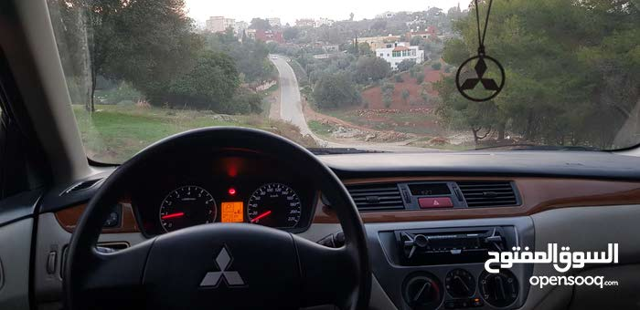 Rent a 2013 Mitsubishi Lancer with best price