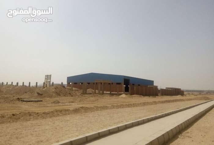 ارض صناعية  للبيع بافضل منطقة صناعية بمصر