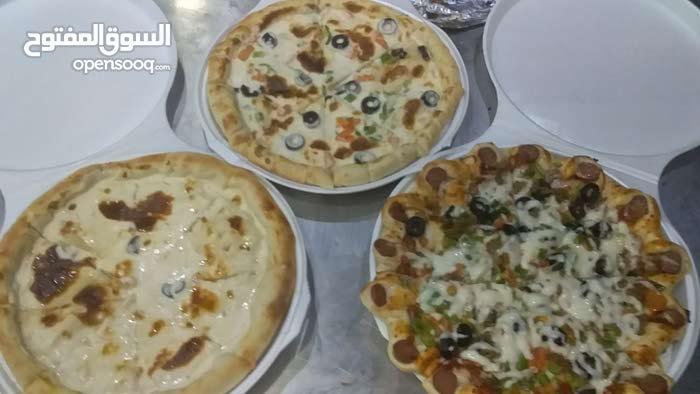 الذ بيتزا وفطاير وبرجر طازج