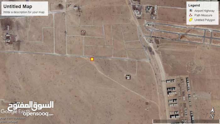 طريق المطار الجيزه قرب الجامعه الصينيه مساحه 993م على شارع معبد