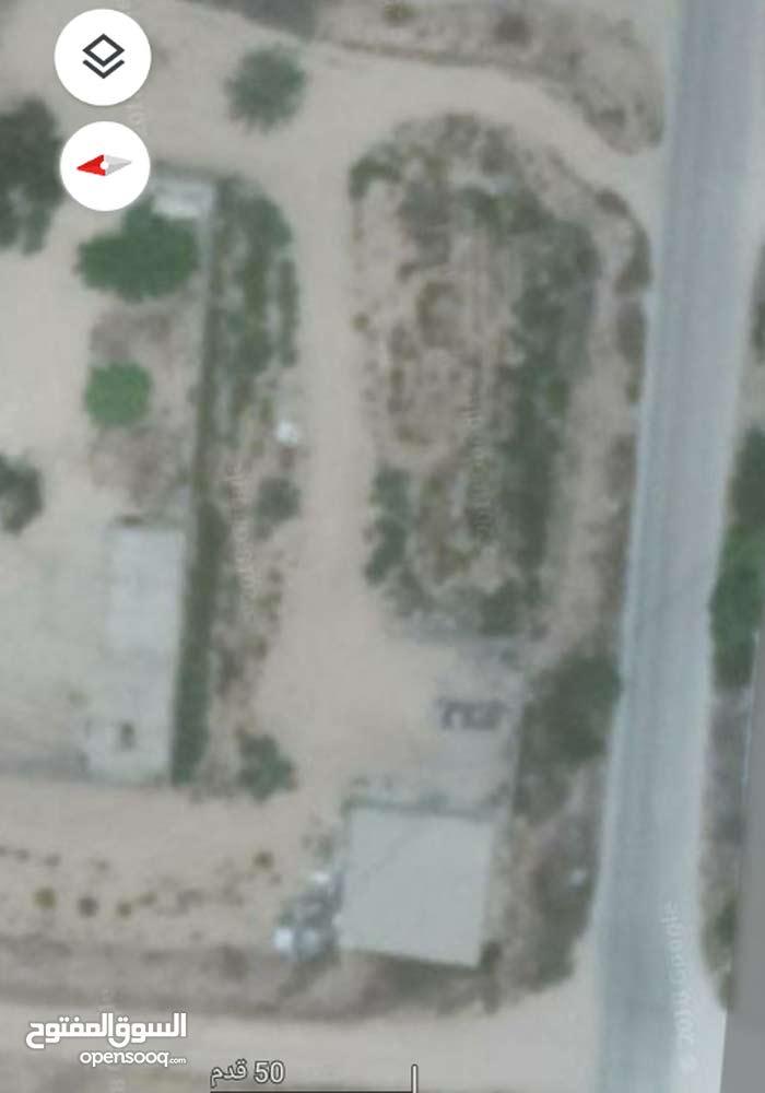 قطعة ارض للبيع  علي الطريق الدافنيه