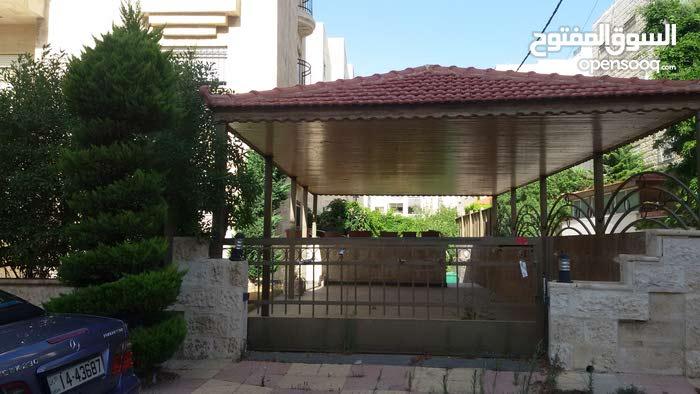 شقة أرضية 330م في الرابية  مع حديقة وكراج خاص