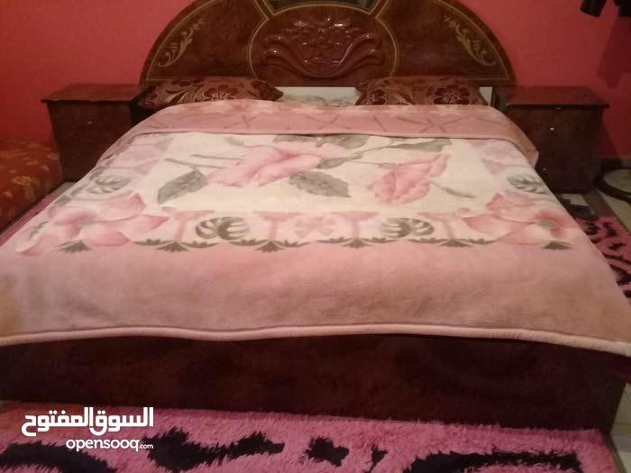 غرفة نوم بحاله جيده اللوح الدولاب والسرير نضاف مافيهاش خبوش امورها كويسه
