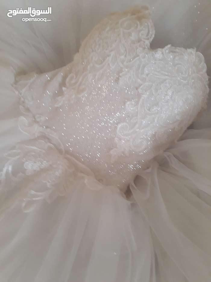 بدلة عروس ابيض مستعمل مرة للايجار او البيع