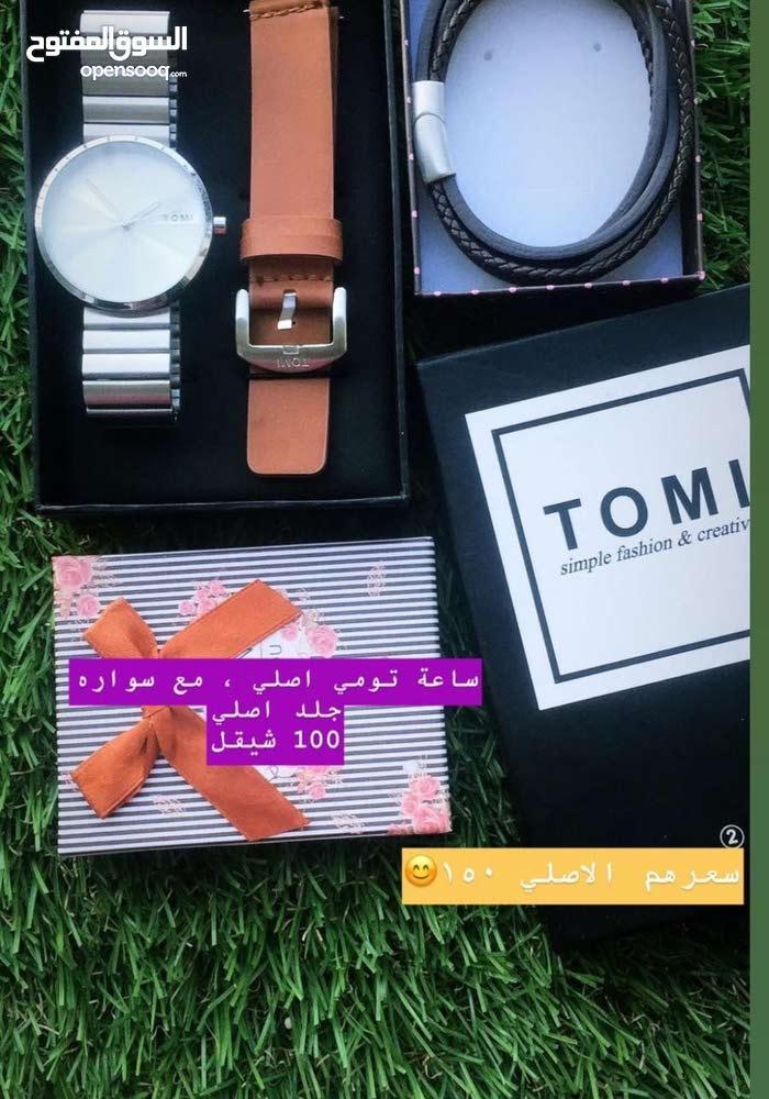ساعة تومي اصلي مع سواره جلد اصلي 100 شيقل