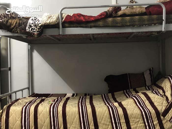 سرير لشخص واحد (طابقين) ب 10 دينار