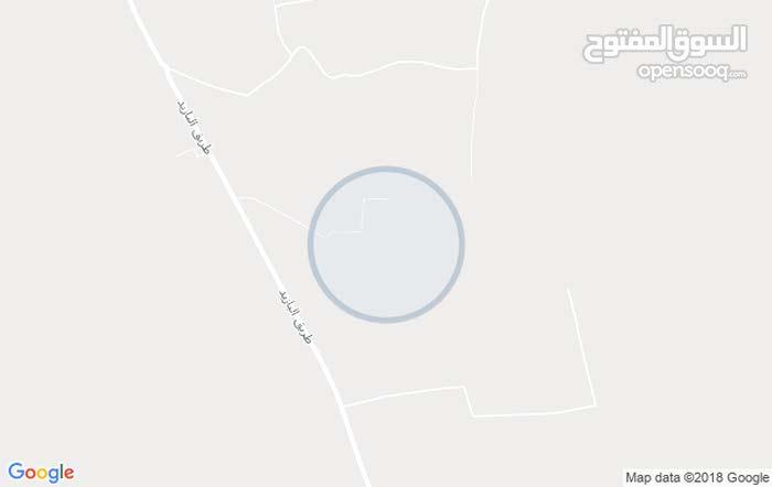 قطعة أرض واجهتين مساحتها350م2 وادي الربيع