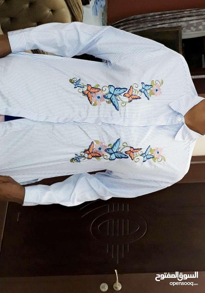 قميص باكمام طويله