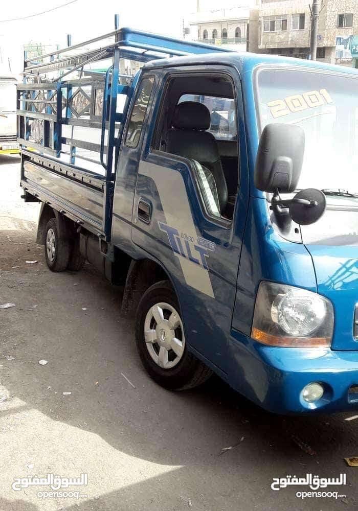 Manual Blue Kia 2001 for rent