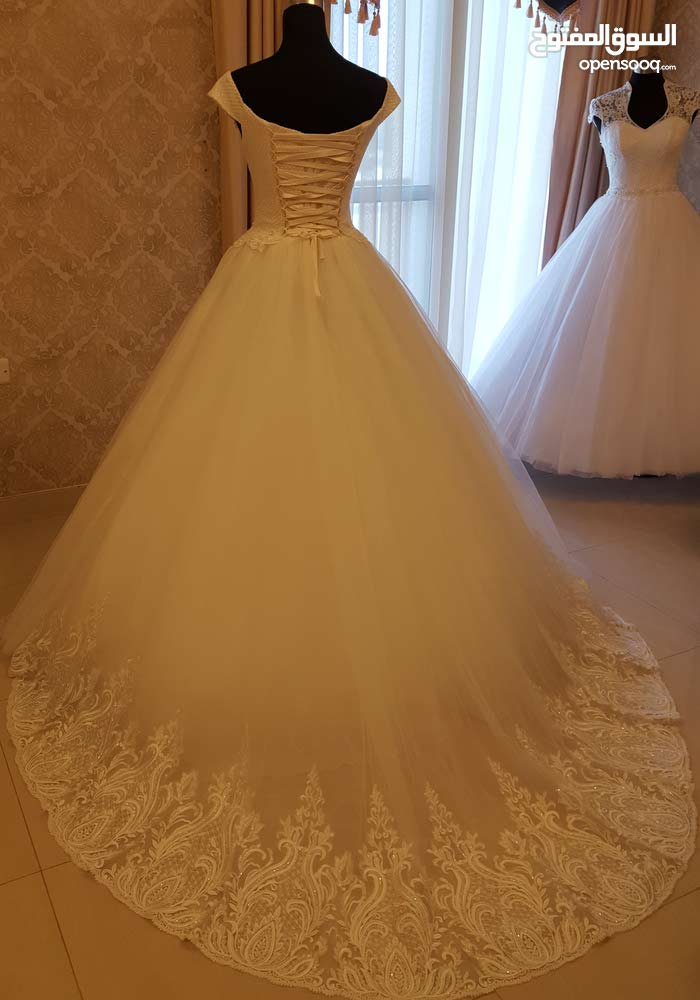 european designs wedding dresses new &used for rent or sell