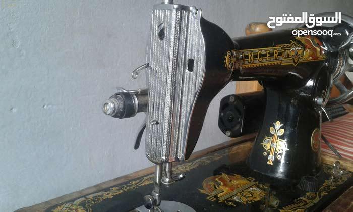 ماكينة خياطة منزلية سنجر