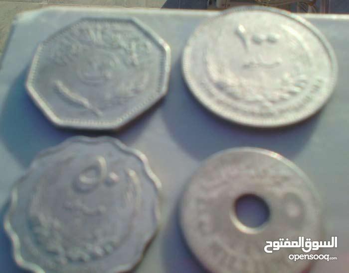 2عملة المملكة اللبية لسنة 1965+1عملة عراقية لسنة 1981ومليم قديم جدا لسنة 1956