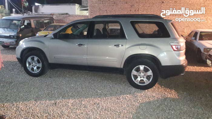Gold GMC Acadia 2009 for sale