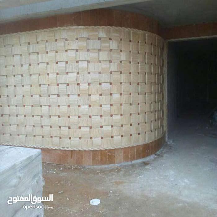 محمد ابو احمد لتلبيس لحجر وتصميم بيروت خلدة