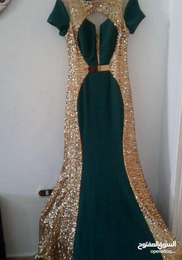 فستان اخضر فيذهبي للبيع ملبوس مرتين السعر 300د وقابل للنقاش