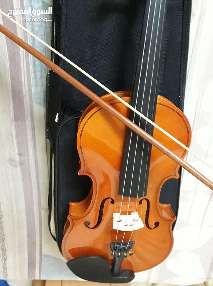 آلة موسيقية كمنجا جديدة مع شنطتها الخاصة للبيع