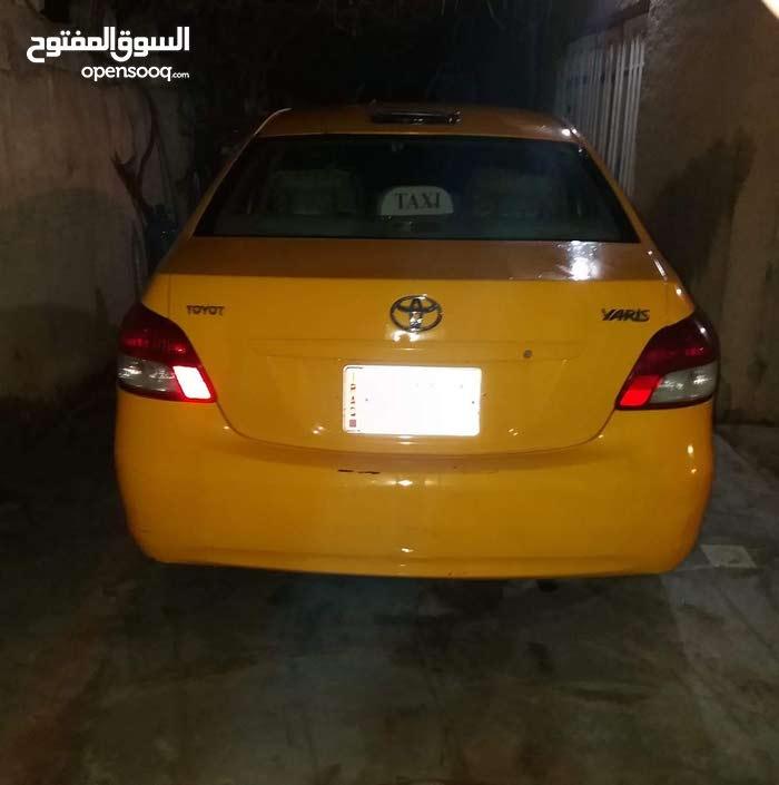 For sale 2008 Orange Yaris
